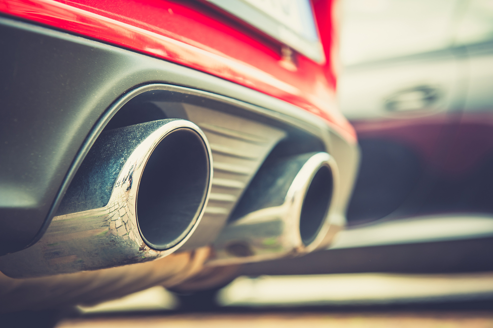 close up of a car chrome dual exhaust pipe on modern sports car