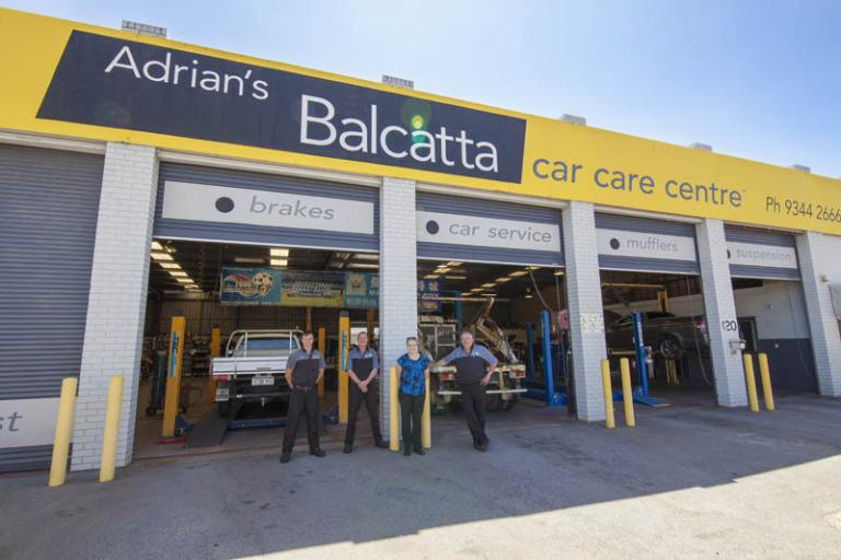 employees of adrian's balcatta car care centre posing for a photo in from of their workshop