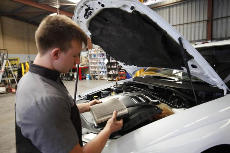 auto mechanic cleaning car filter in adrian's balcatta car centre workshop