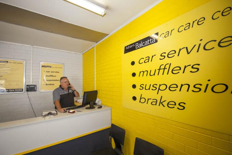 receptionist answering the phone in adrian's balcatta car care centre foyeur